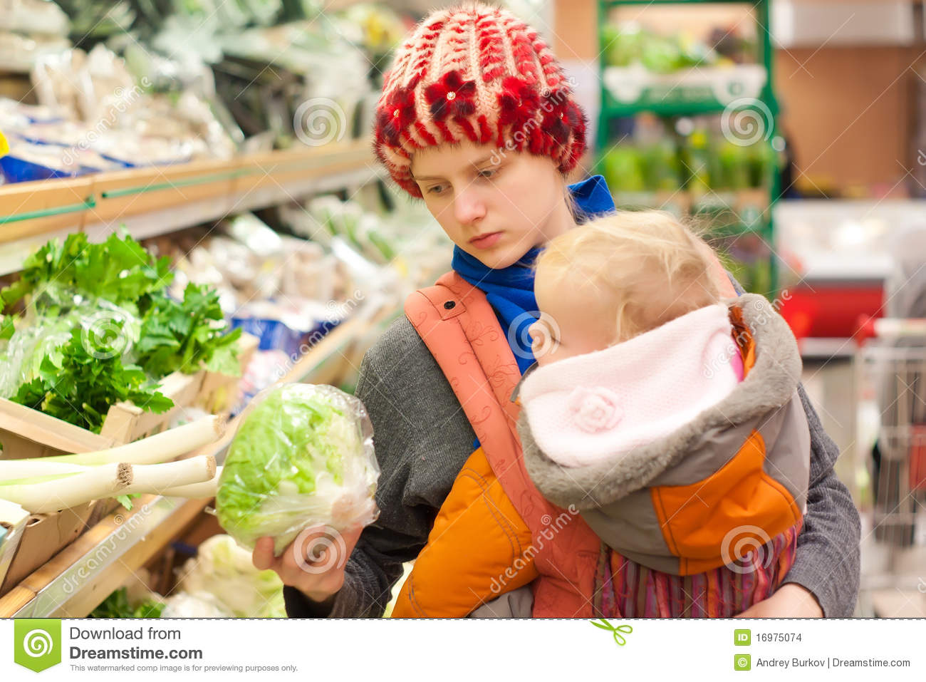 Mother with girl shopping in supermarket
