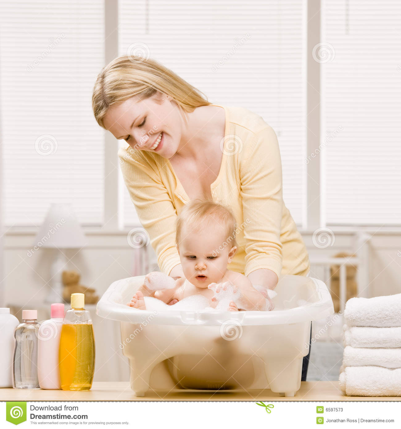 Mother Give Baby Girl A Bath Stock Image - Image of innocence ...