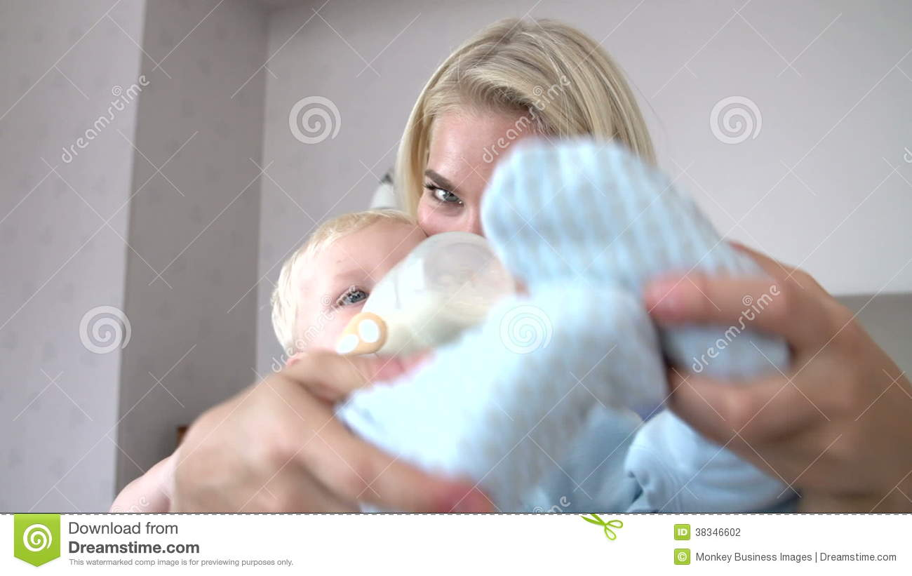 Mother Giving Baby Son Bottle Of Milk Stock Video Footage - Video of ...