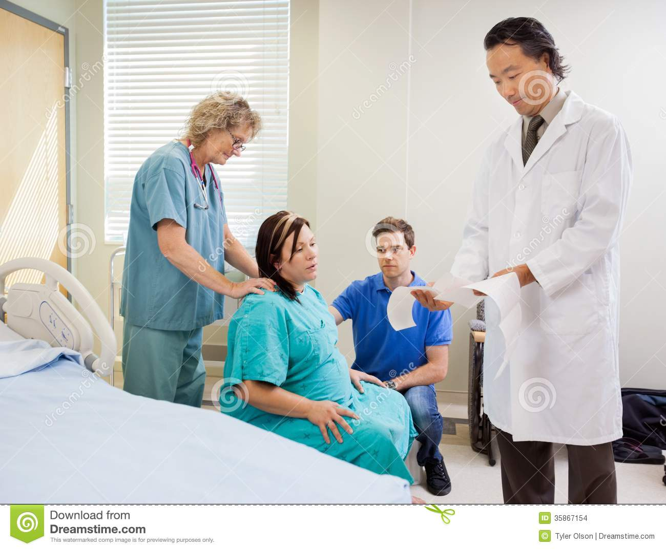 mother giving birth in hospital stock images