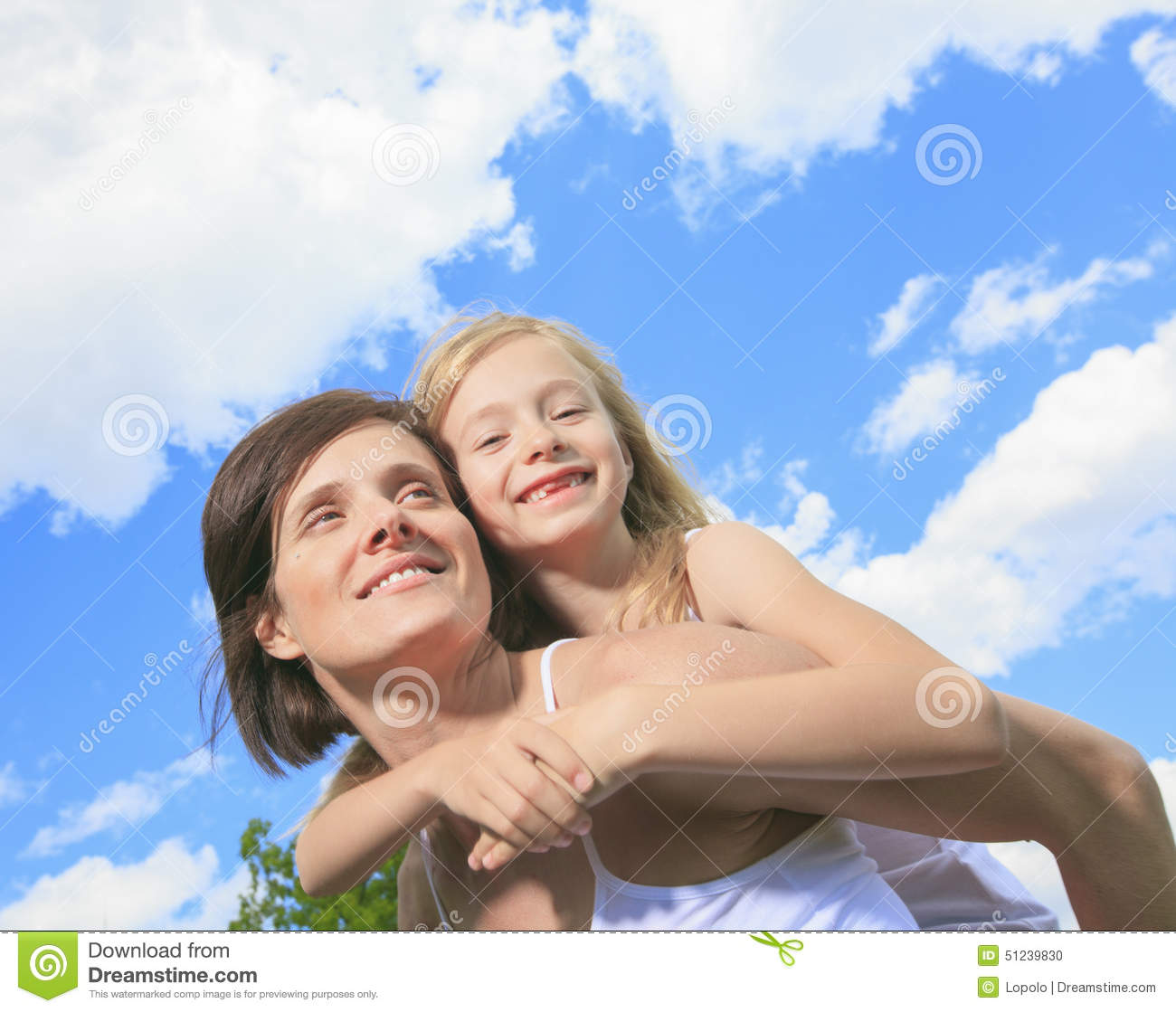 Mother Giving Her Daughter A Piggy Back Ride Stock Photo