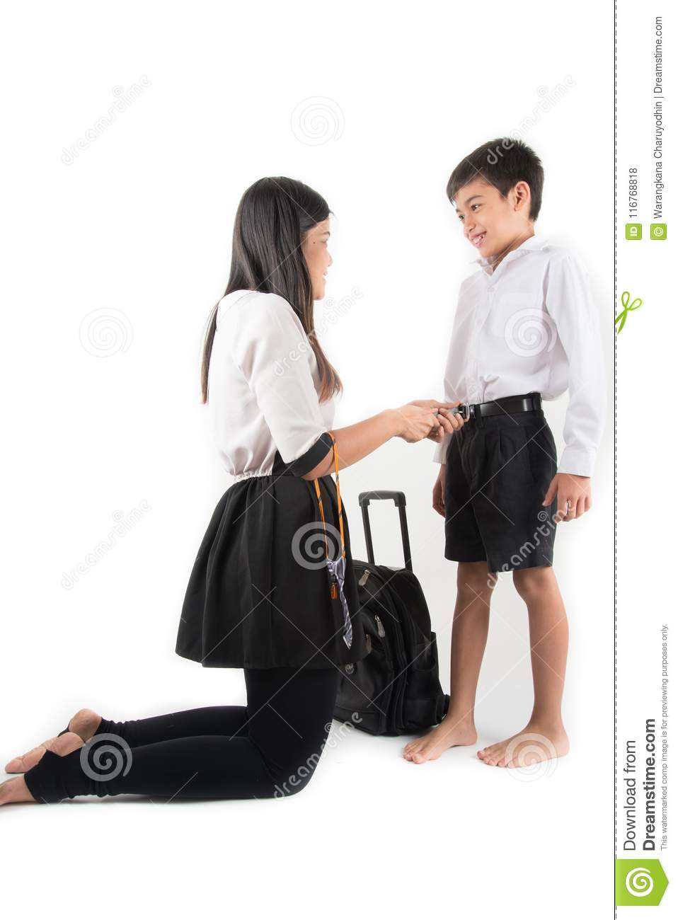 2a297eb90f24 Mother is helping school boy wear neck tie ready for school on the first day