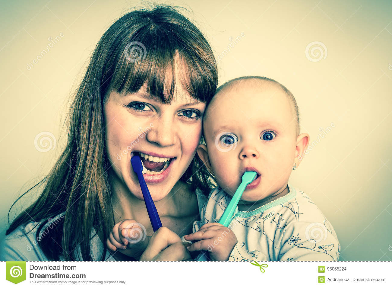 Little Girl And Her Parents Brushing Teeth Together In