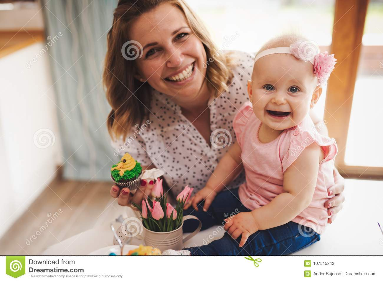 Mother and her baby playing in easter holiday