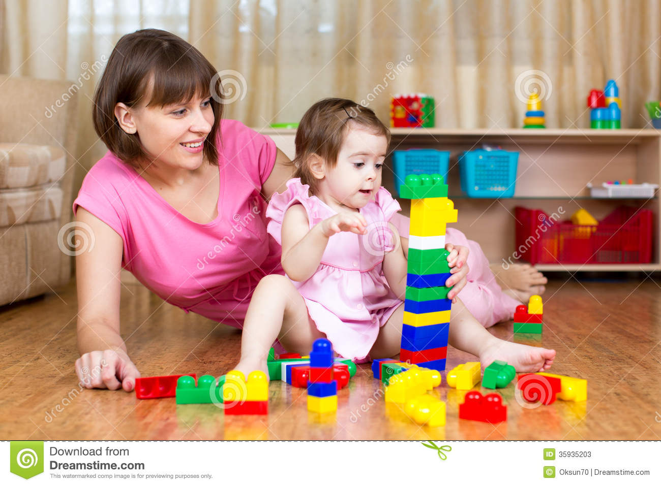 Mom Play Toys : Mother and her daughter play toys stock photos image