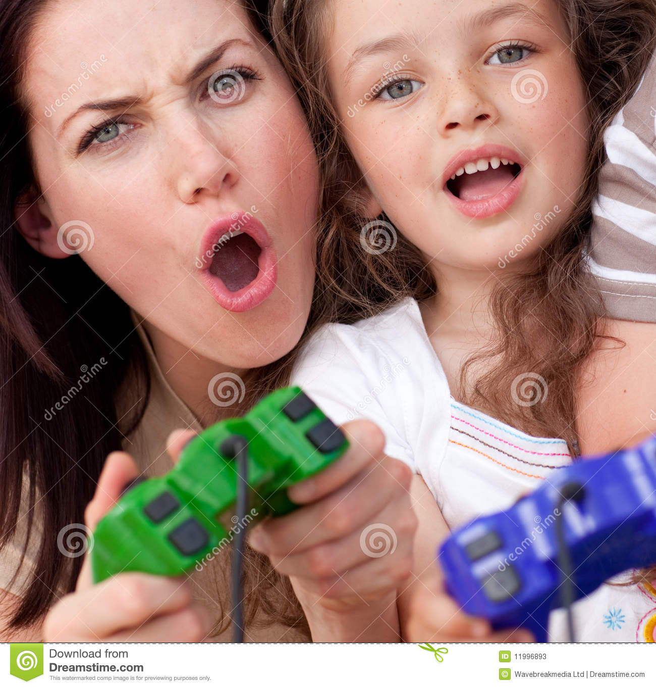 Mother and her daughter playing video games