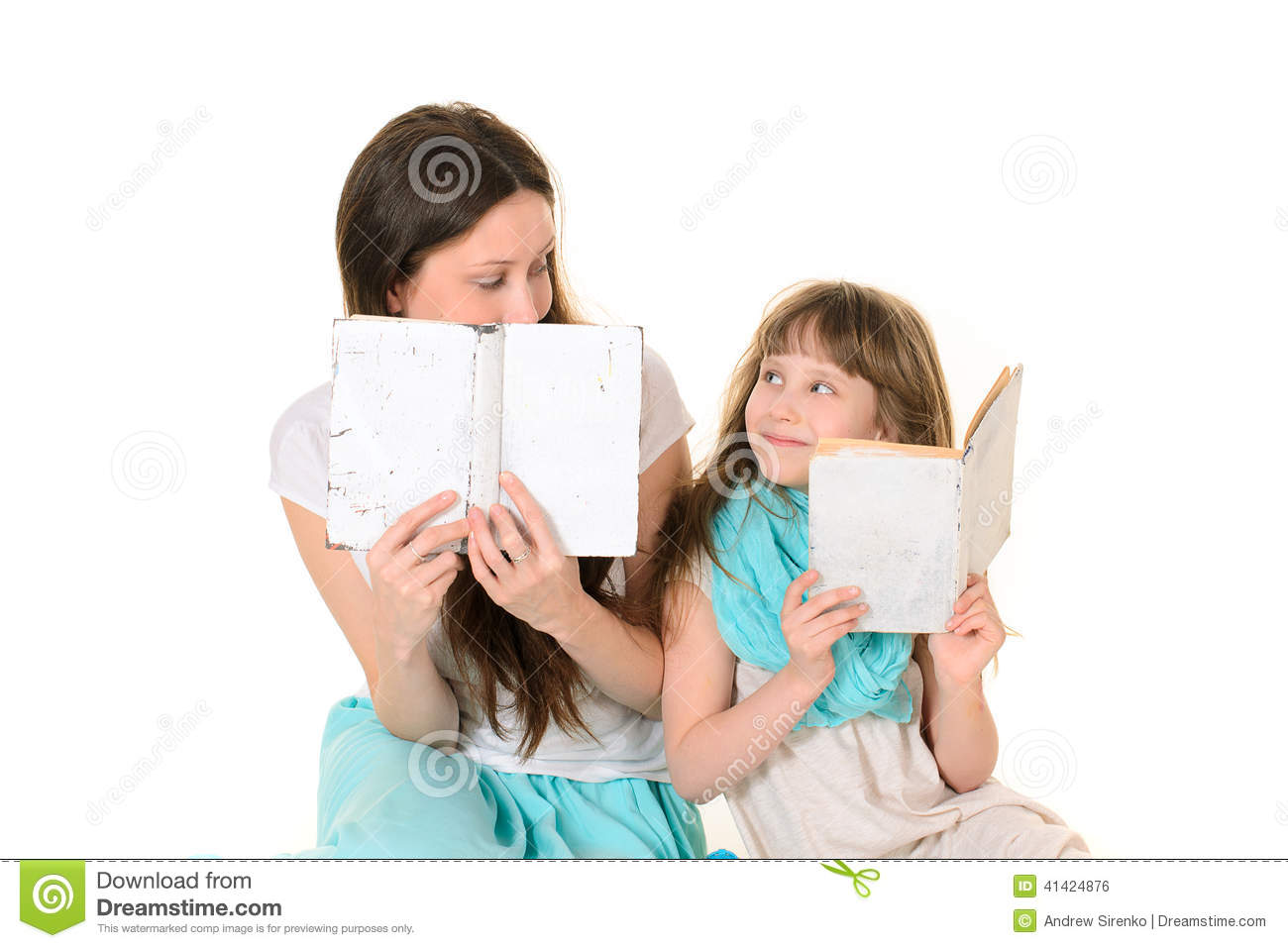 Mother with her daughter reading book