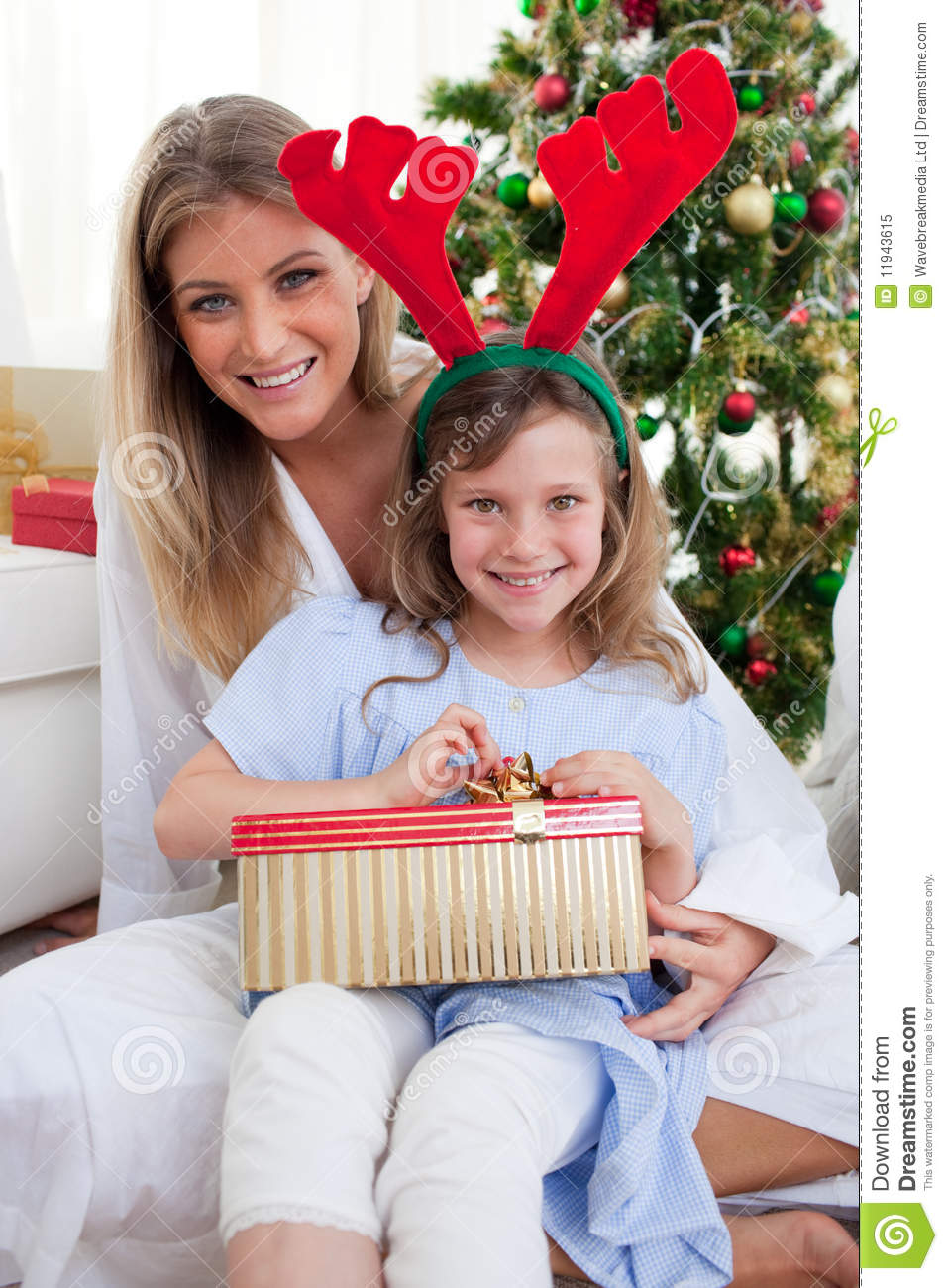 Mother And Her Daughter Unpacking Christmas Gifts Royalty