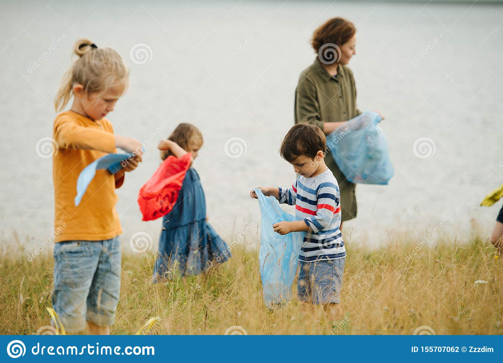 Children collecting water editorial stock image. Image of