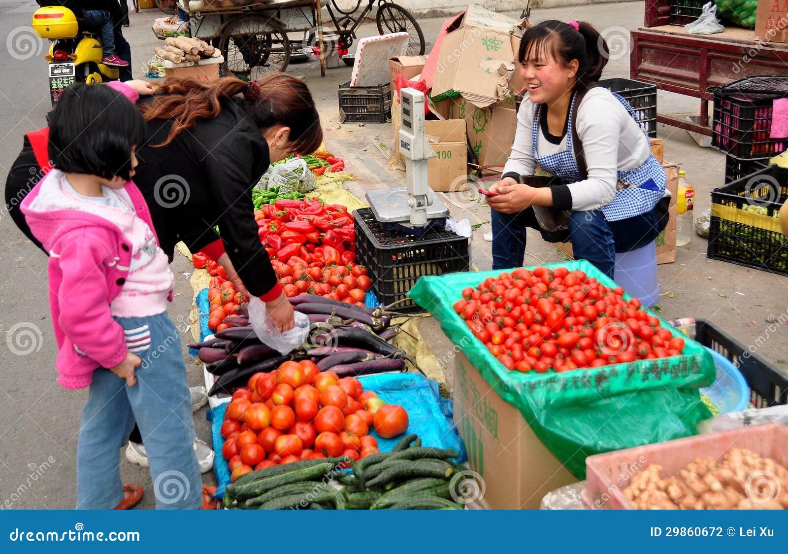 Pengzhou, China: Woman Shopping at Market