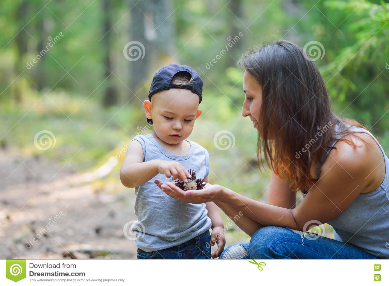 Mother And Her Little Son Discovering Nature Looking On ...