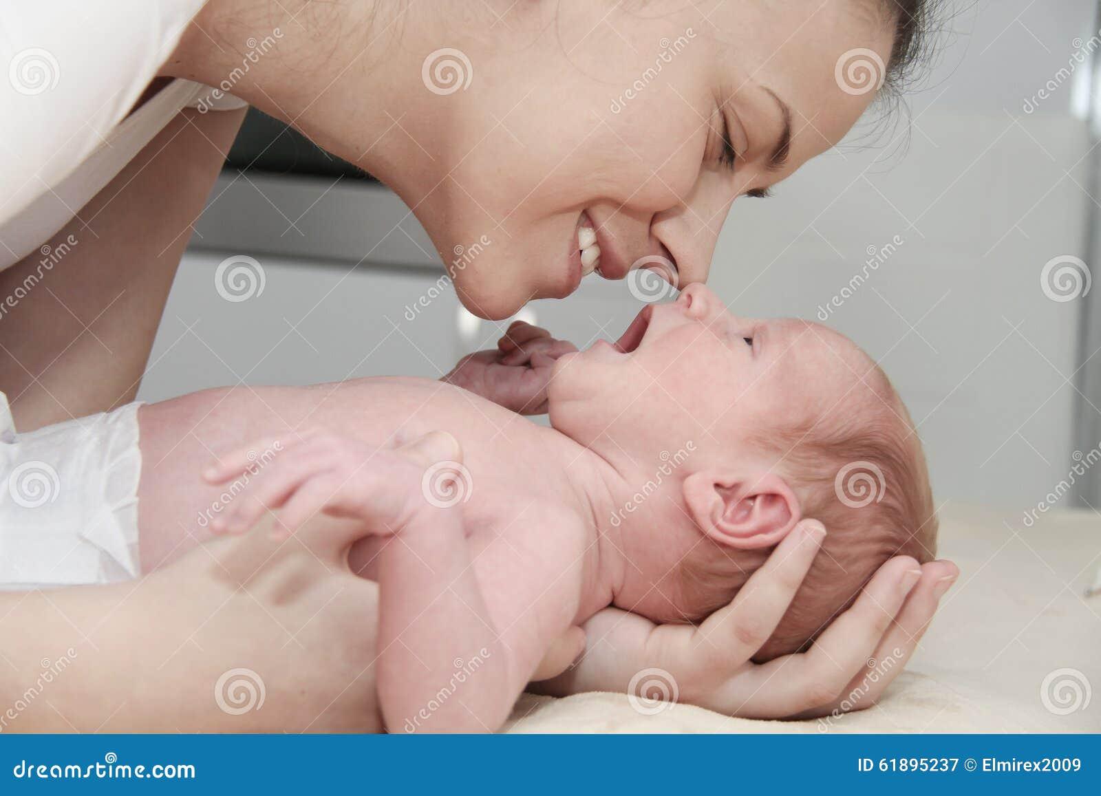 Mother and her Newborn Baby, Parent holding newborns hands