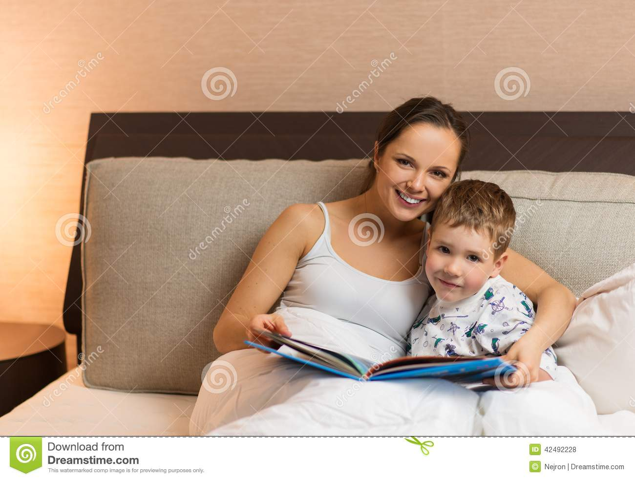 mother and her son reading book stock photo image 42492228. Black Bedroom Furniture Sets. Home Design Ideas