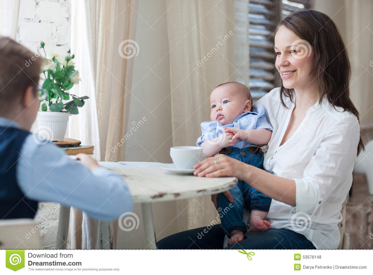 Mother and her sons having lunch together