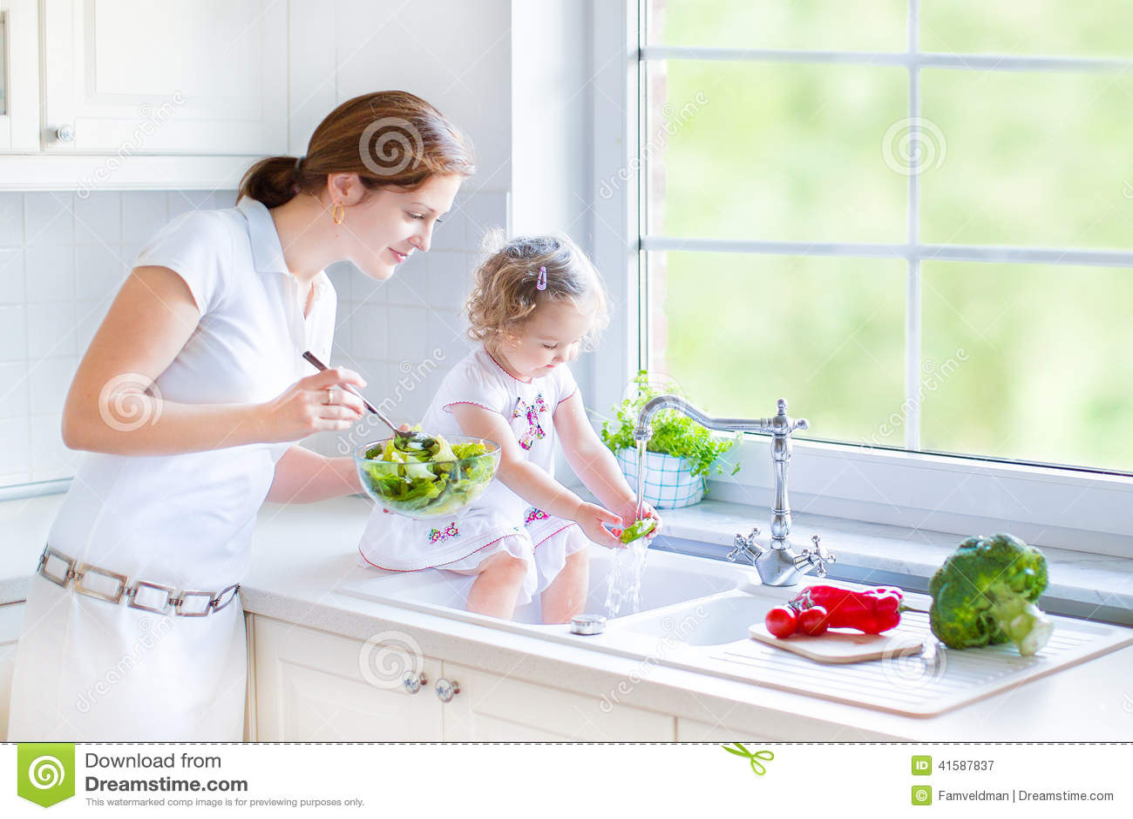 Washing Baby In Kitchen Sink