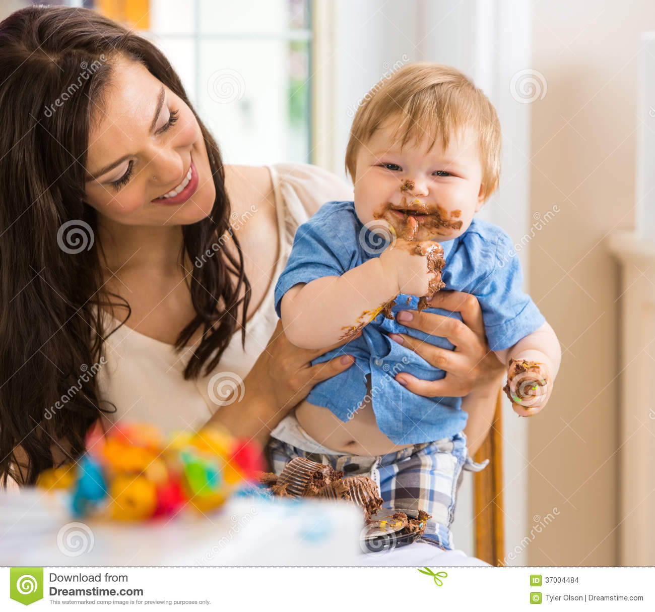 Baby Eating Cake Clipart : Mother Holding Baby Boy Eating Cake With Icing On Stock ...