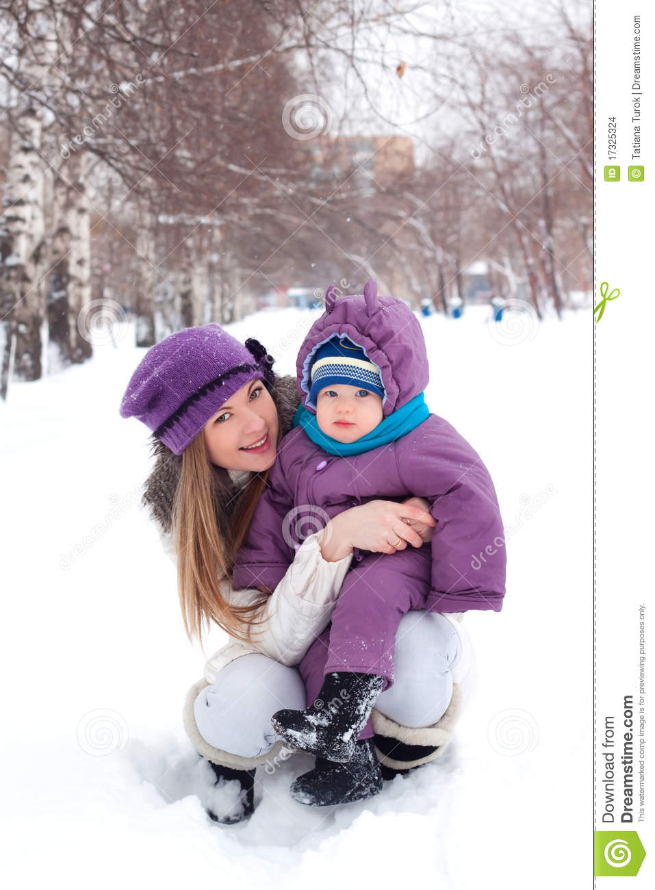 mother holding a baby snow winter park walk royalty free stock photography cartoondealer. Black Bedroom Furniture Sets. Home Design Ideas