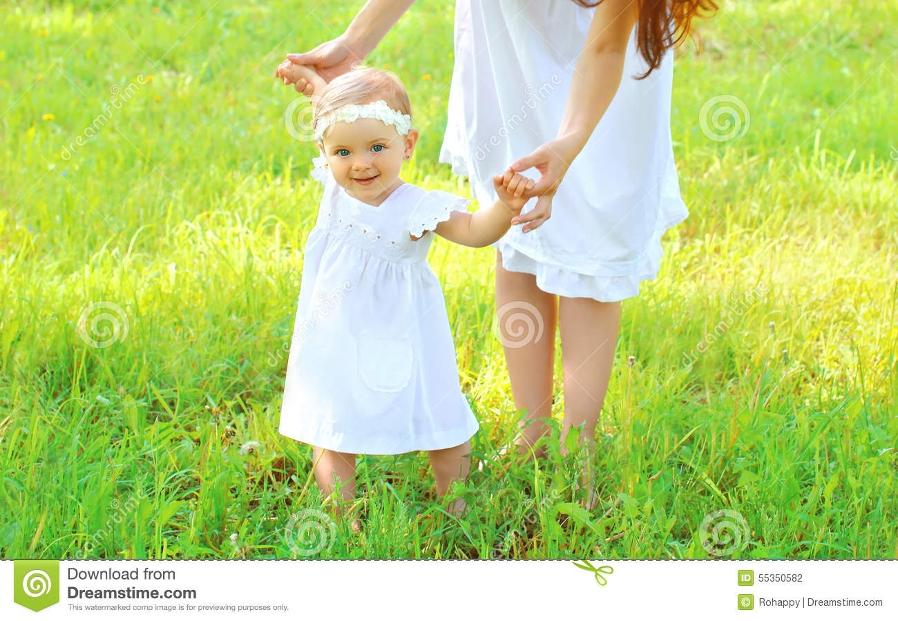 Mother Holding Hands Baby Walking Together Stock Photo