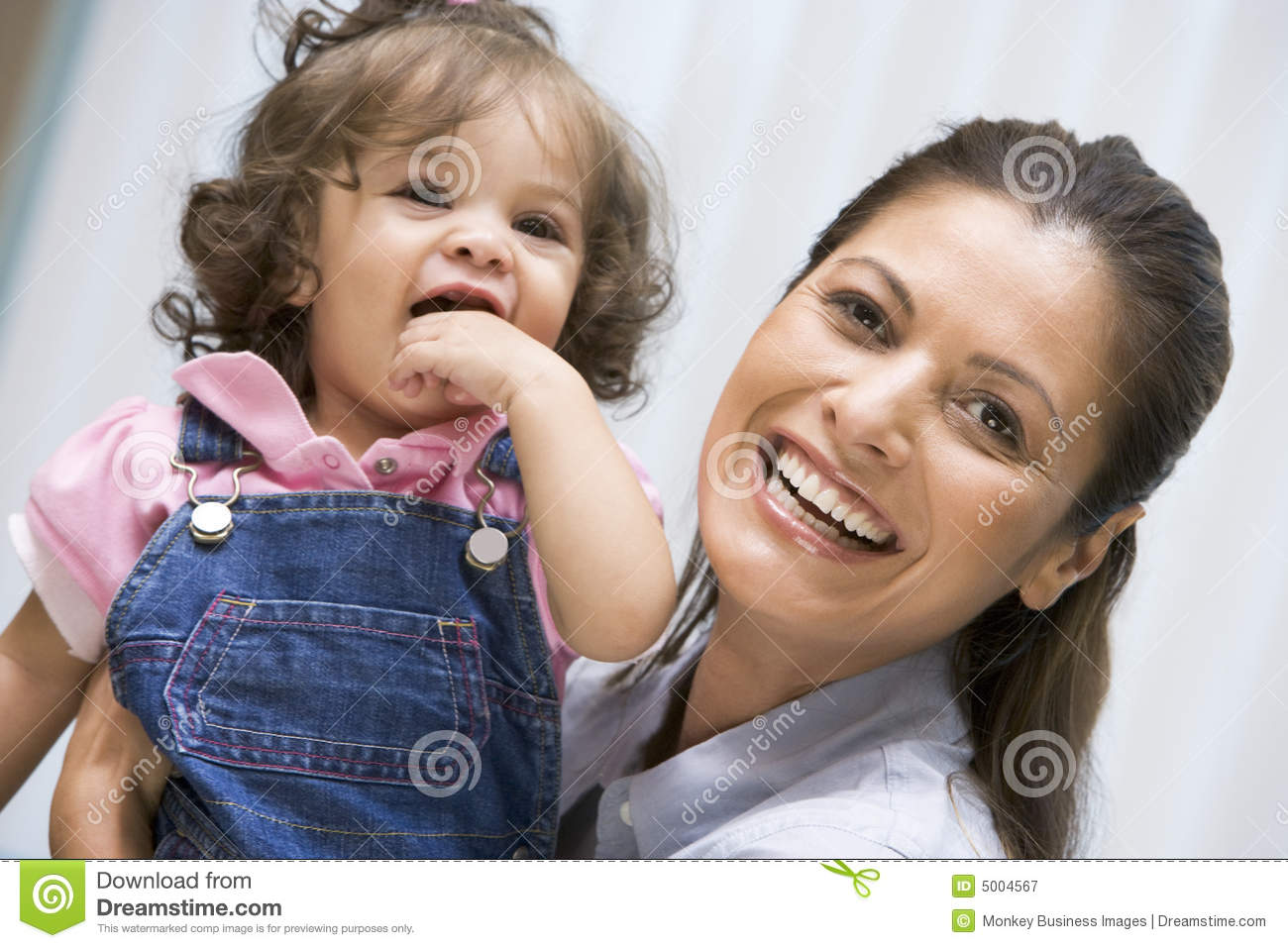 Mother holding young girl