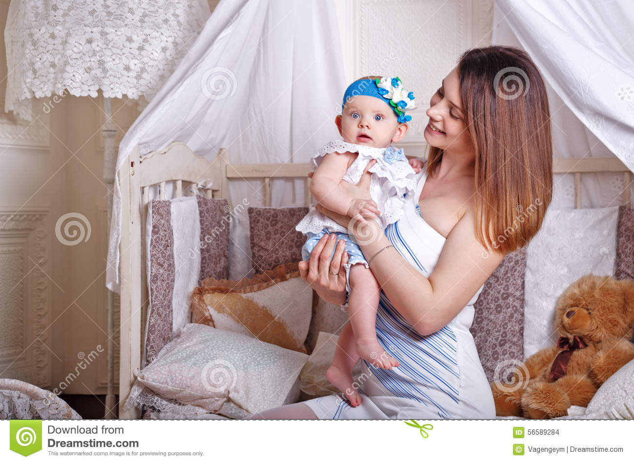 Mother holds the little daughter in her arms.