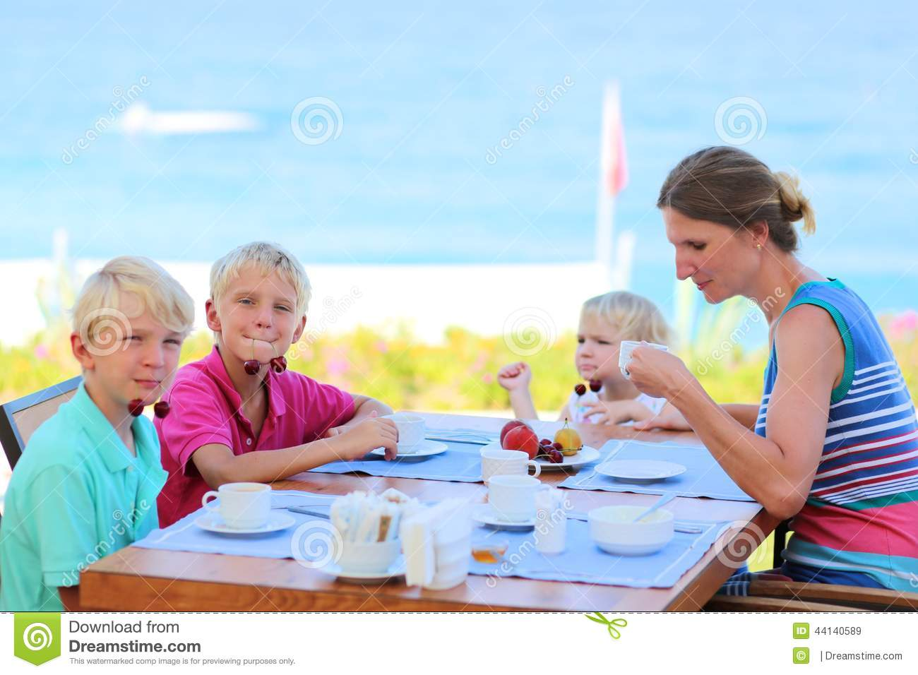 Happy Family Having Breakfast At A Restaurant Mother With Kids In Resort Royalty Free Stock Images