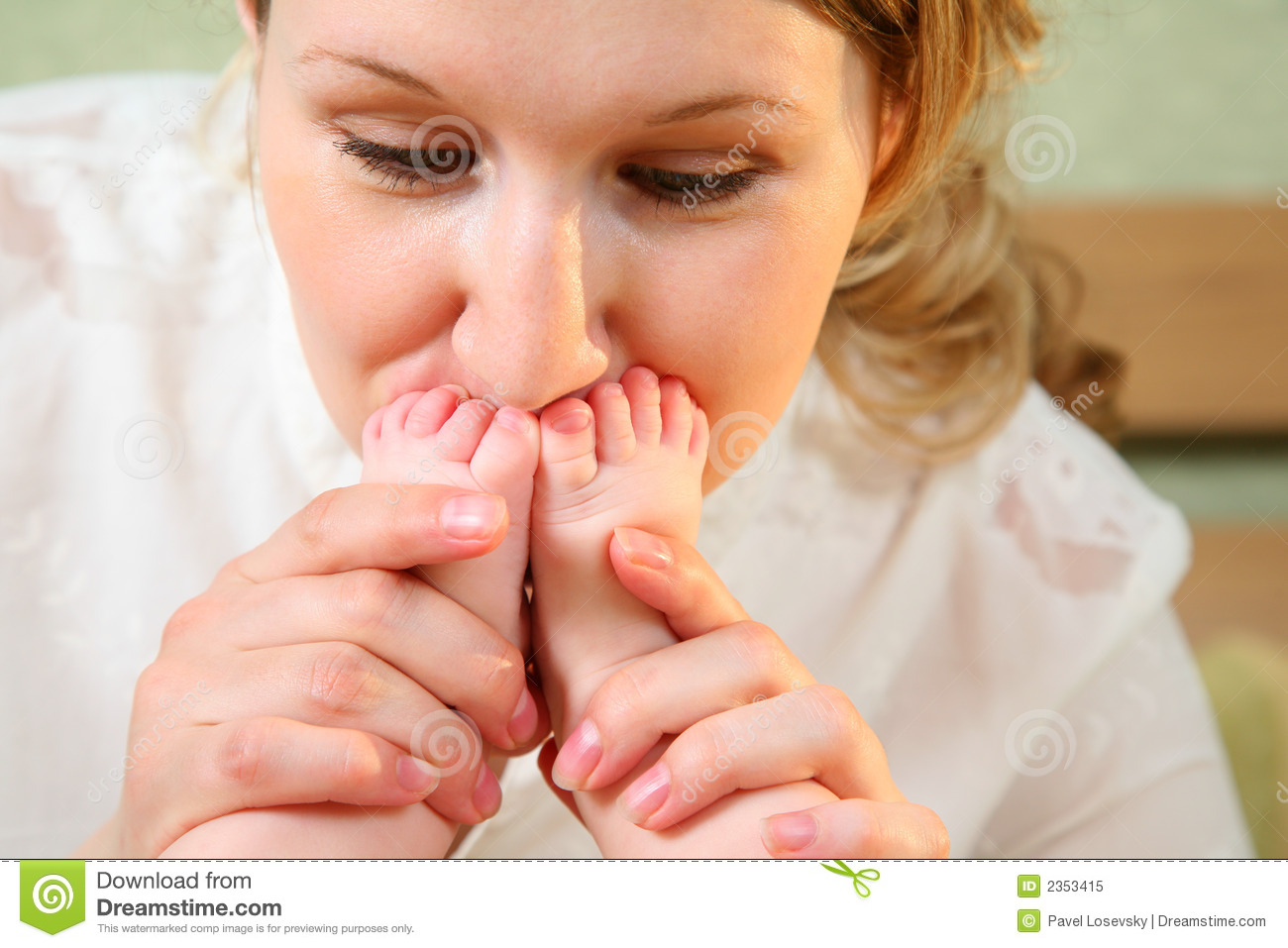 Mother Kiss Baby Legs Royalty Free Stock Photo