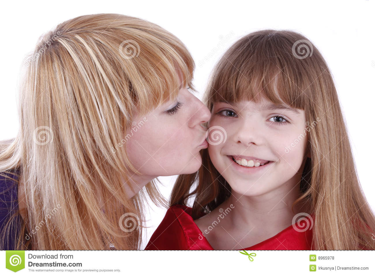 Mother daughter kissing
