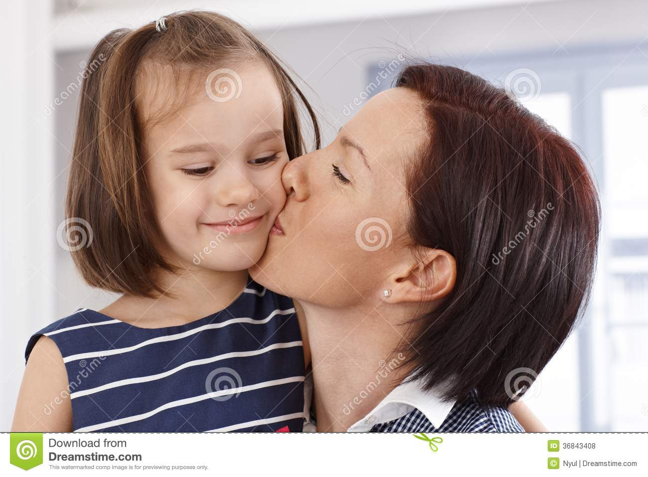 Young girl tongue kissing mom