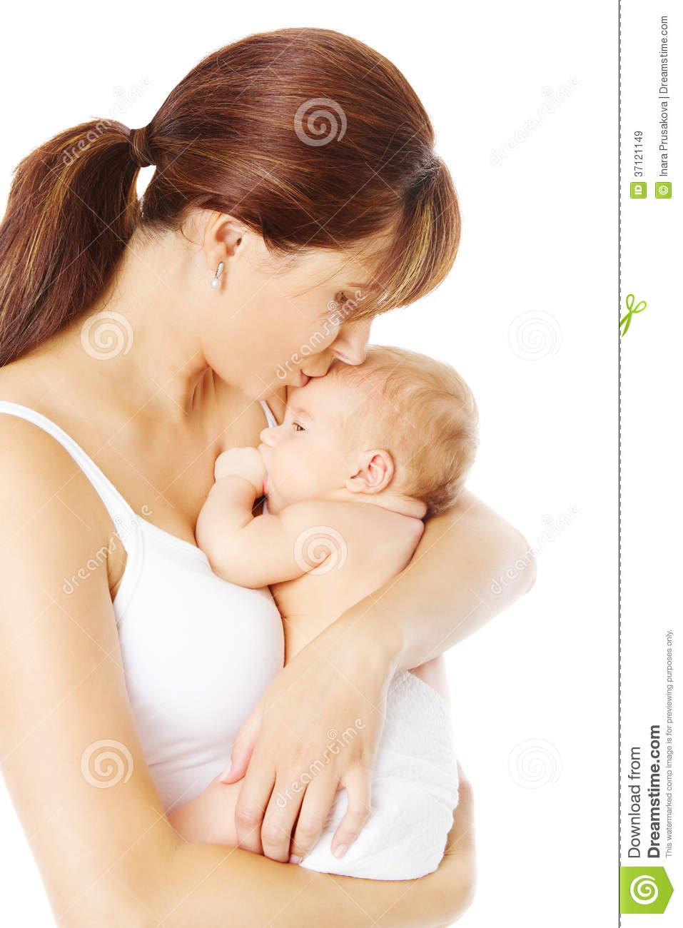 Mother kissing newborn baby holding in hand, white