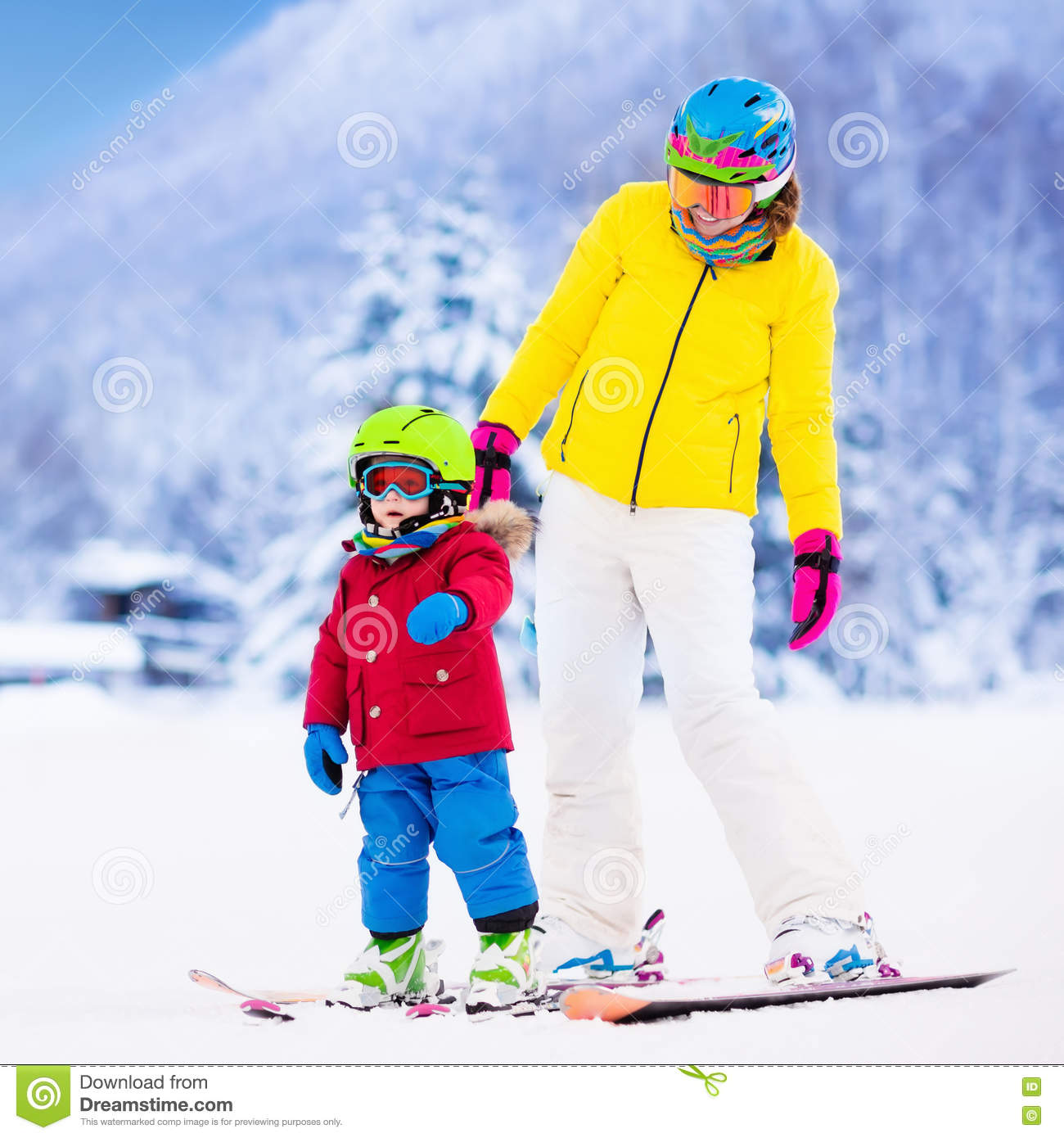 Mother and little boy learning to ski