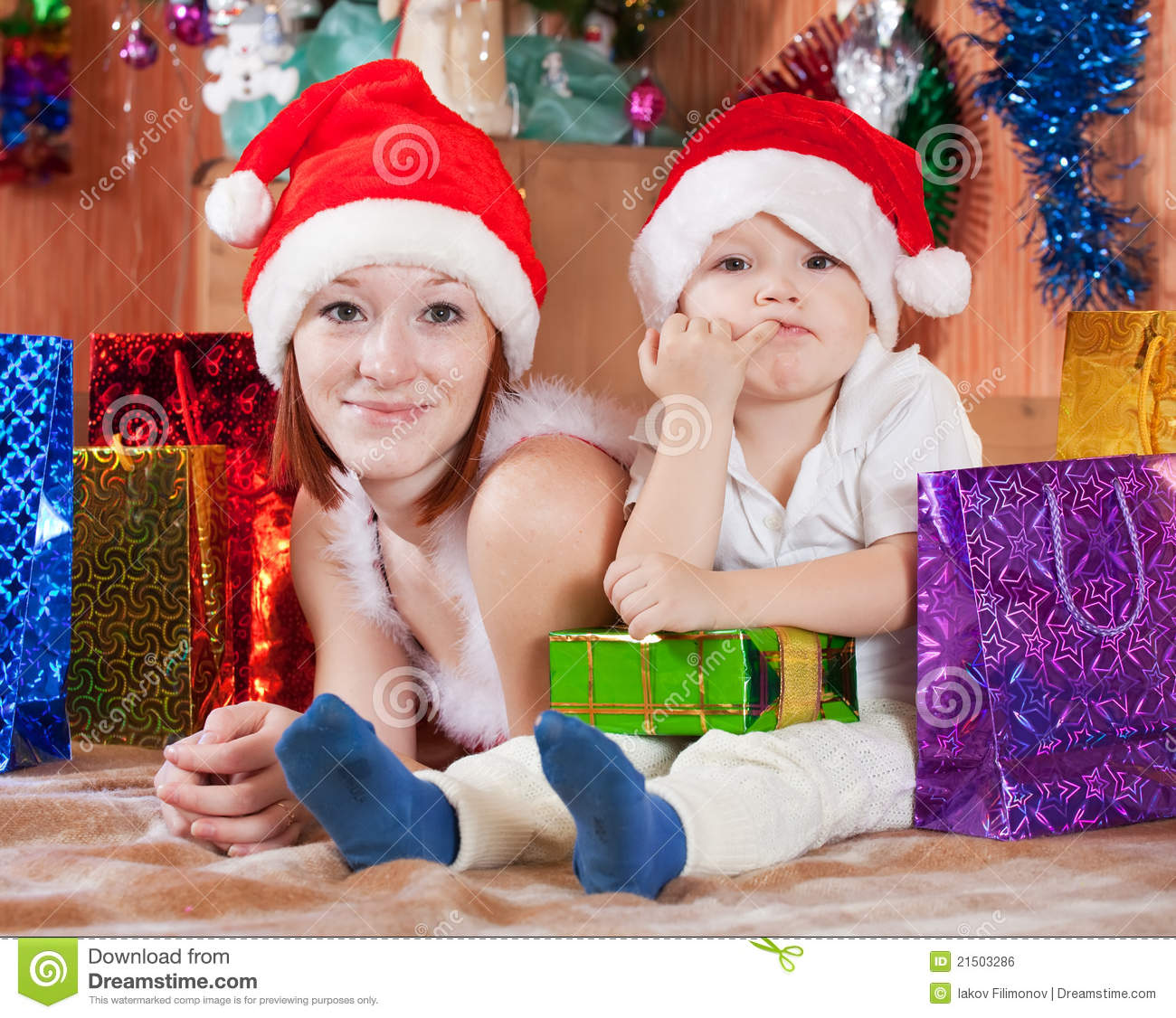 Mother And Little Son With Christmas Gifts Royalty Free