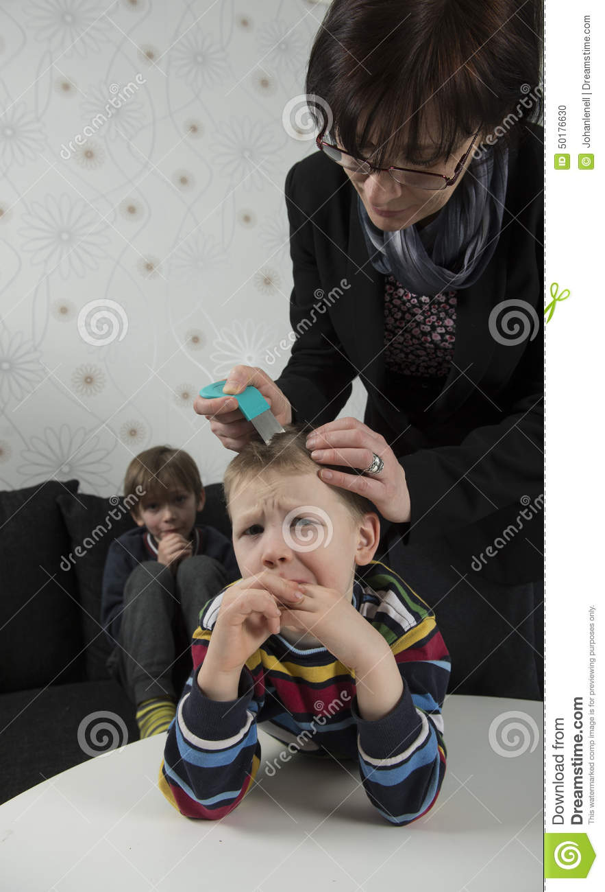 Mother looking for lice on youngsters head