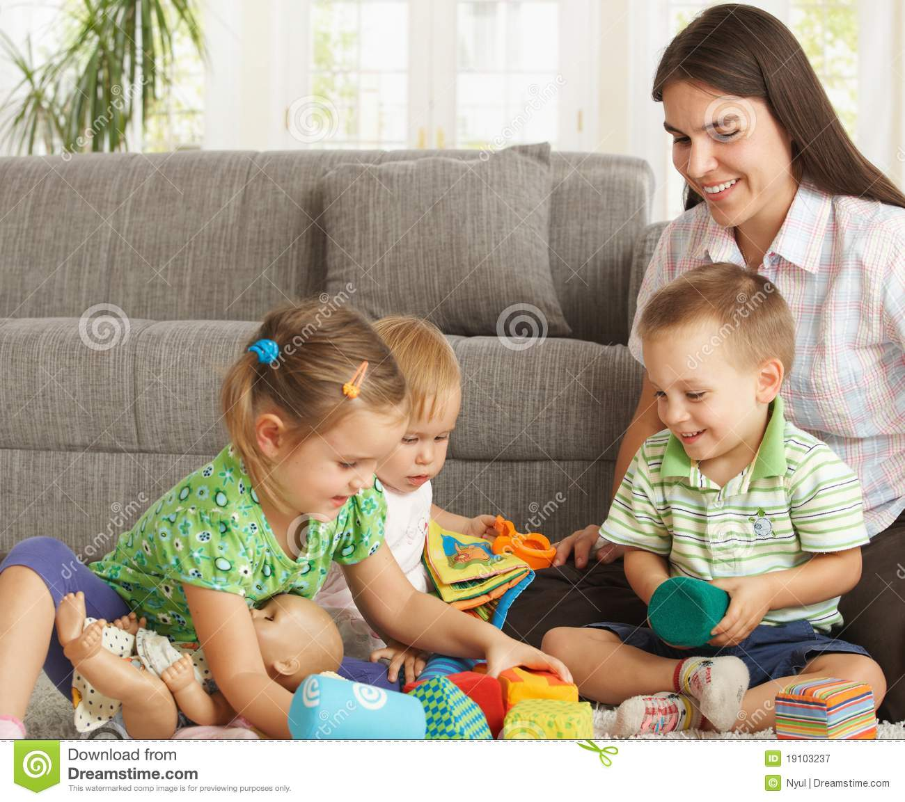 Mother Playing With Children At Home Stock Image - Image of
