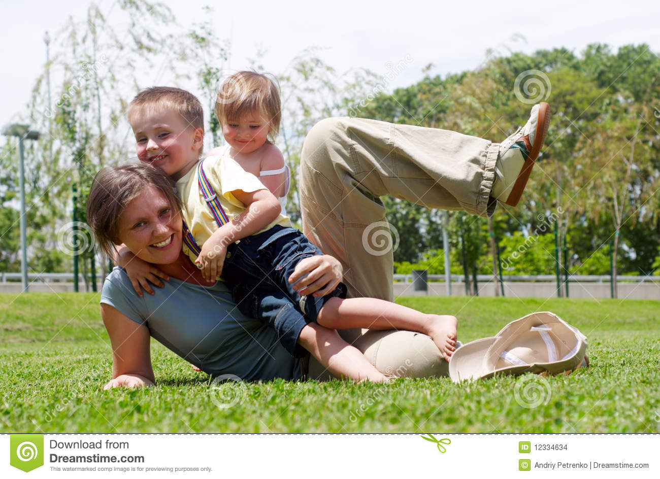 Mother Playing Soccer In Park With Son Stock Photo