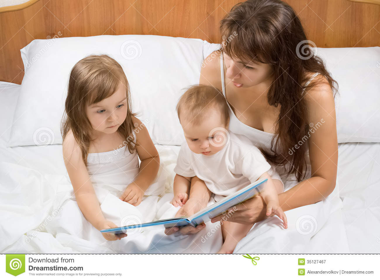 Mother reading bed time story book to children stock image for Bed stories online