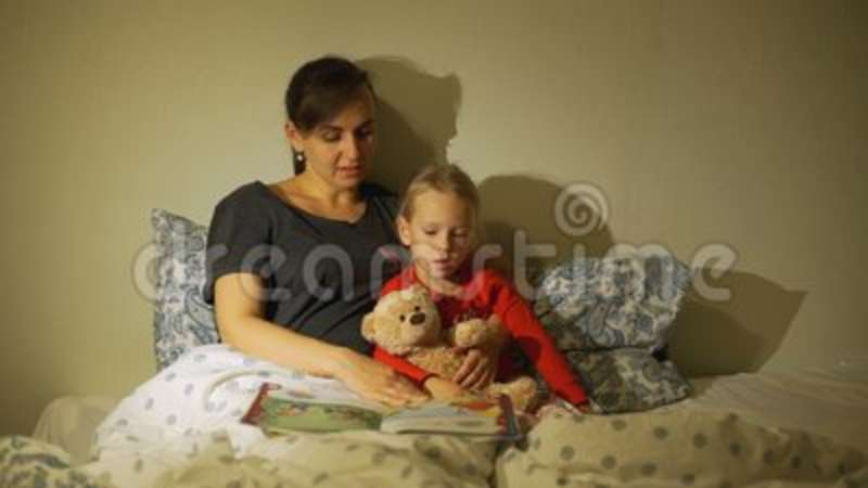 Mother Reading Bedtime Stories to her Child