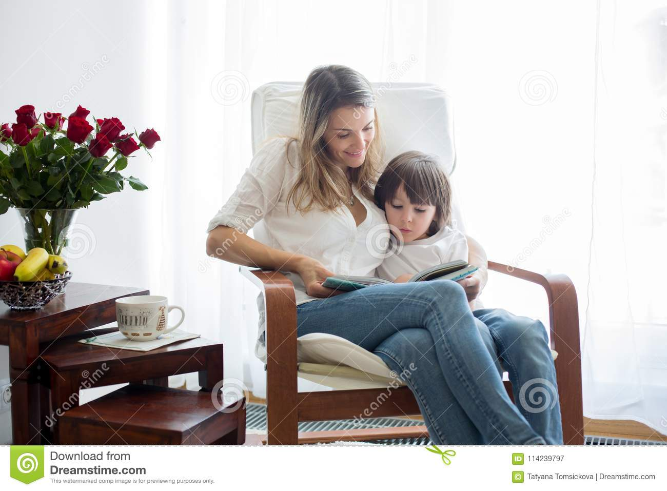 Picture of: Mother Reading A Book To Her Child Sitting In Rocking Chair Stock Image Image Of Cheerful Greeting 114239797
