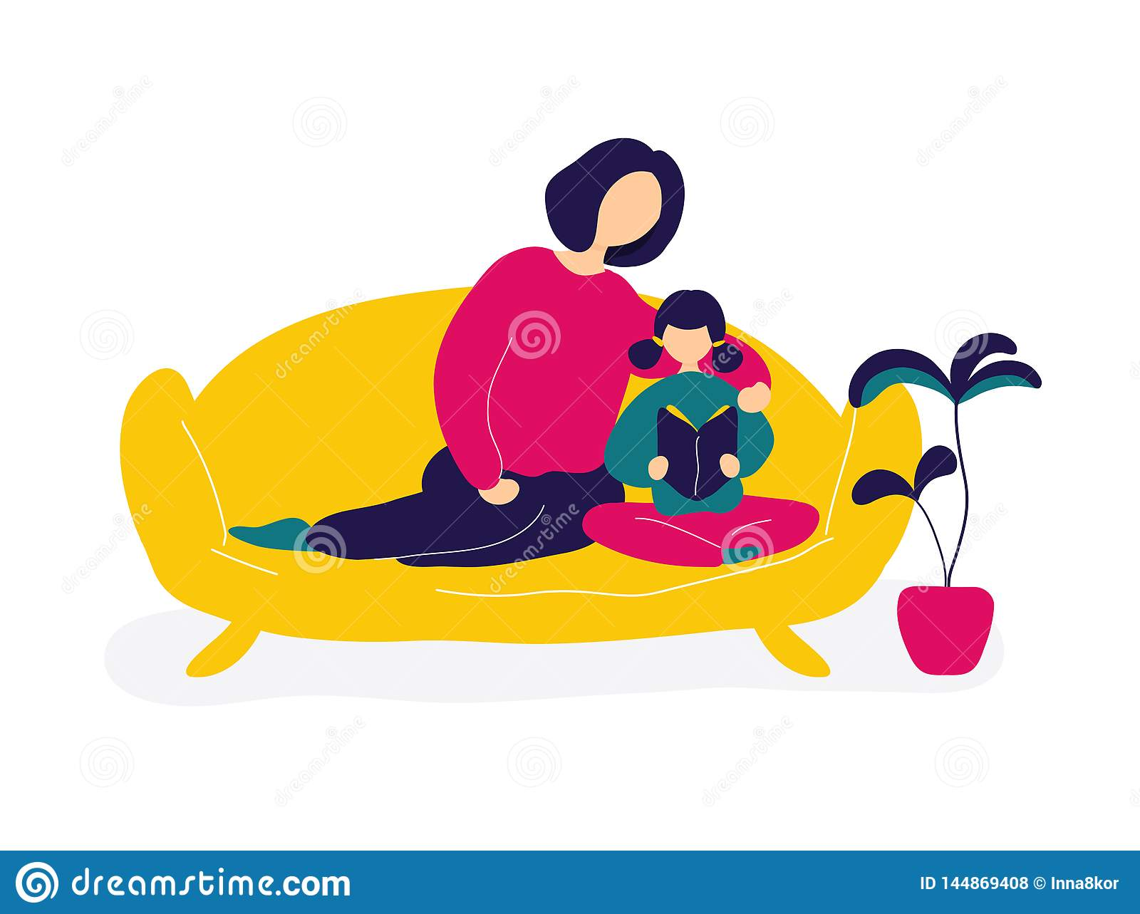 Mother reading books with daughter on sofa