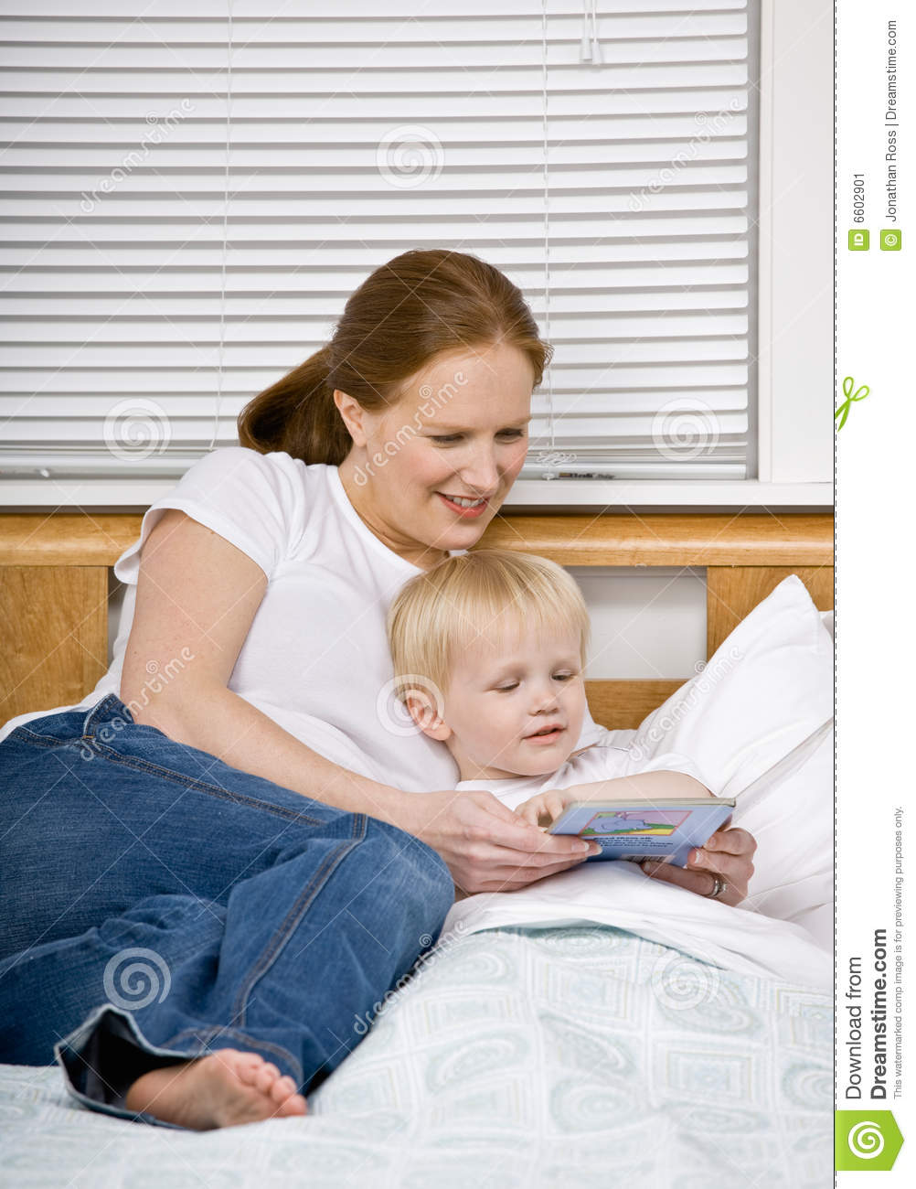 mother reading son a bedtime story in bed stock image image 6602901. Black Bedroom Furniture Sets. Home Design Ideas