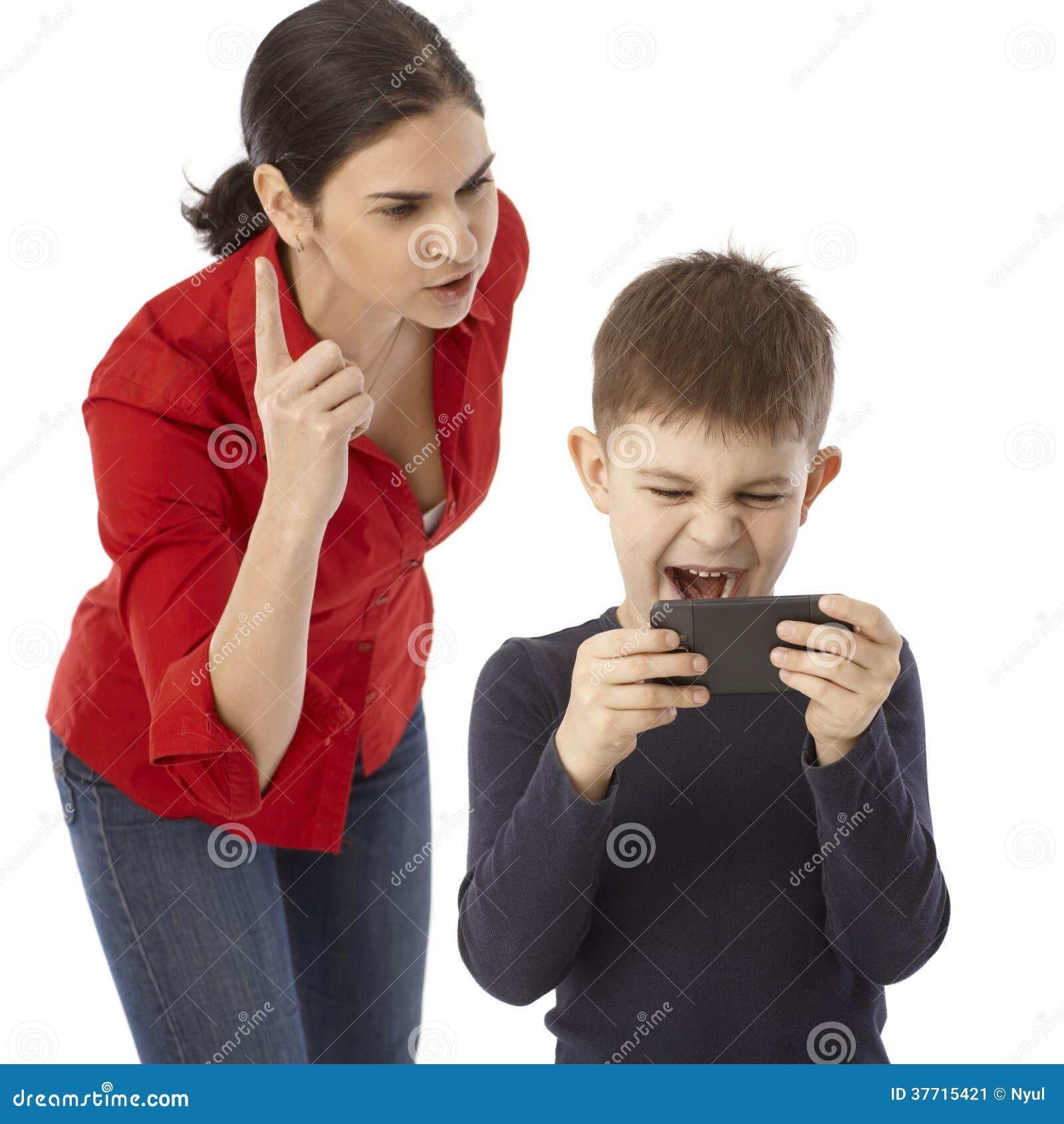 Mother rebuking naughty little boy