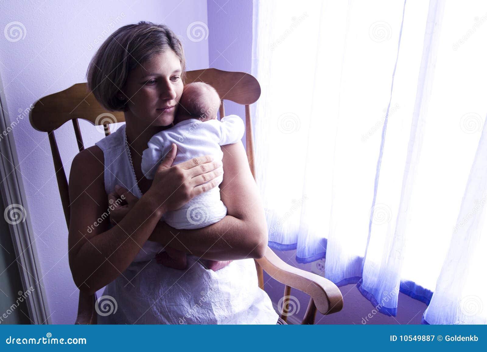 Mother Rocking Newborn Baby Stock Image Image Of Family