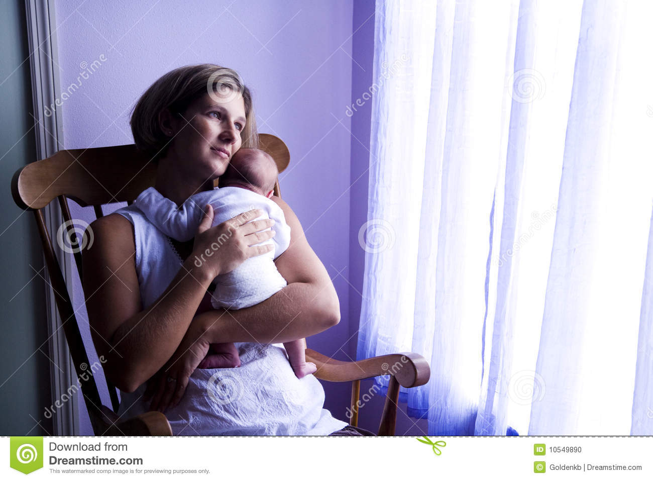 Mother Rocking Newborn Baby By Window Stock Photo - Image: 10549890