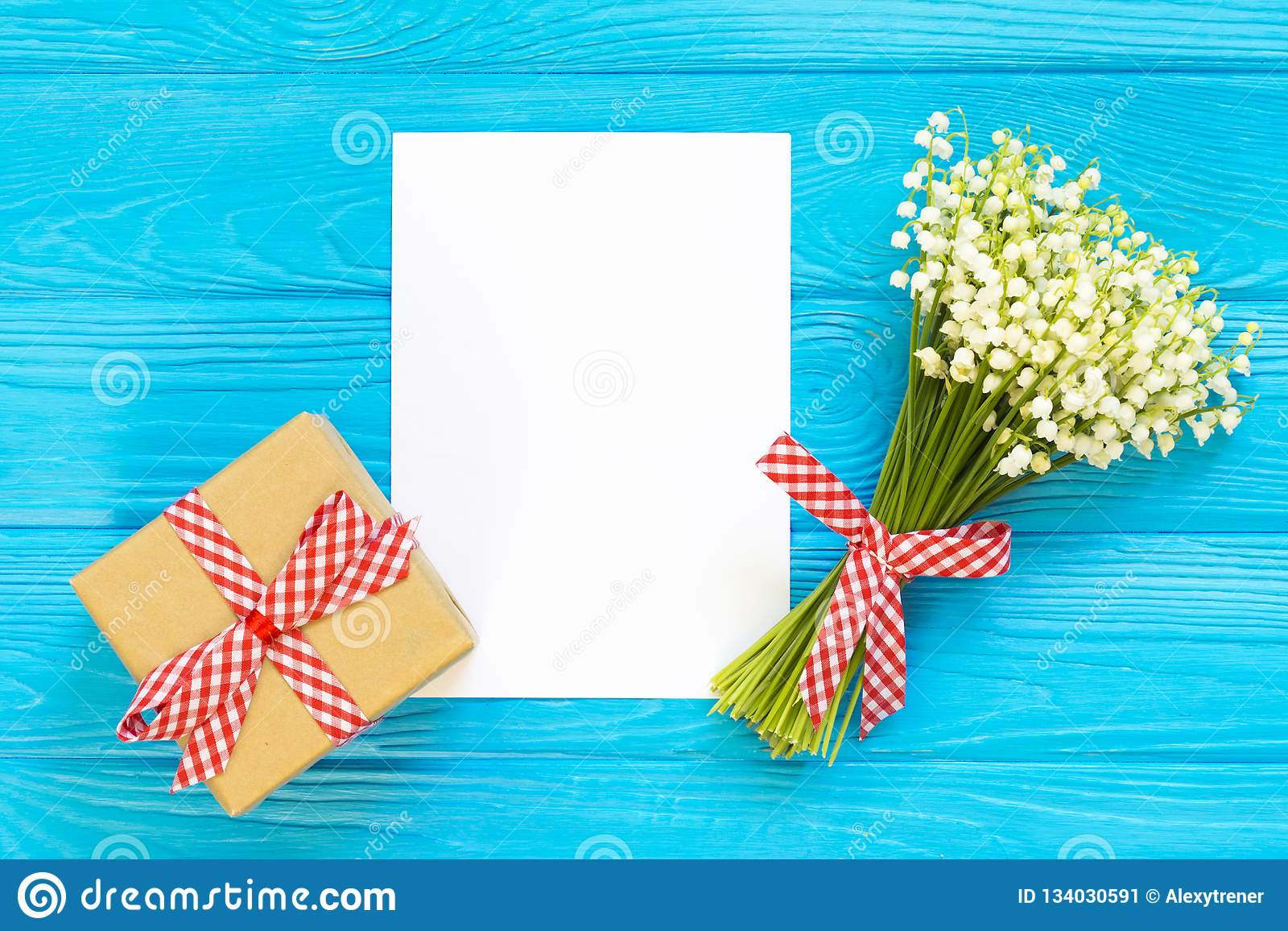Womens Day Valentines Birthday Background Lily Of The Valley Envelope Packing Gifts Flat Lay Top View