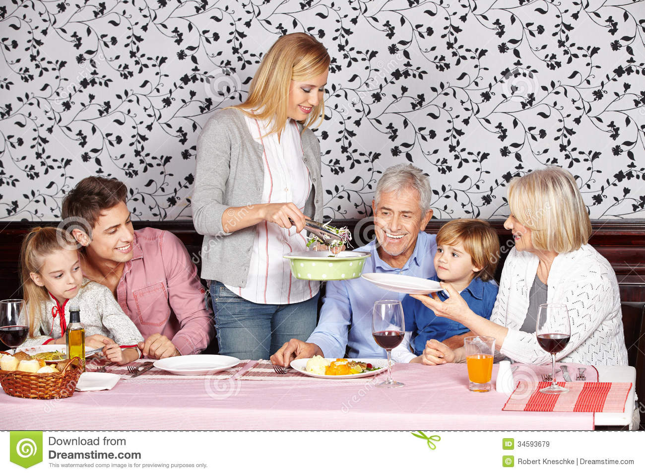 Mother Serving Food To Family At Stock Image Image 34593679