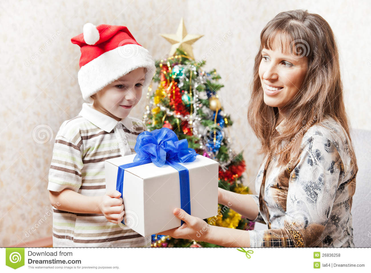 Mother and son with christmas holiday gift box royalty Christmas gift ideas for mom from son