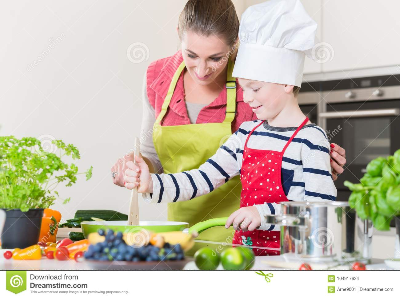 Mother and son cooking family dinner together