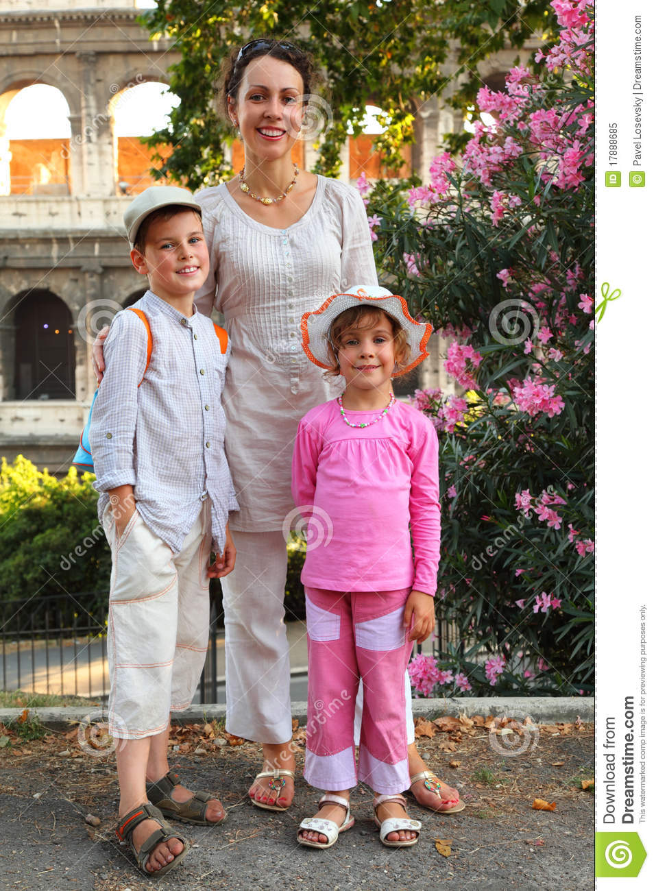 Mother, son and daughter are near Colosseum