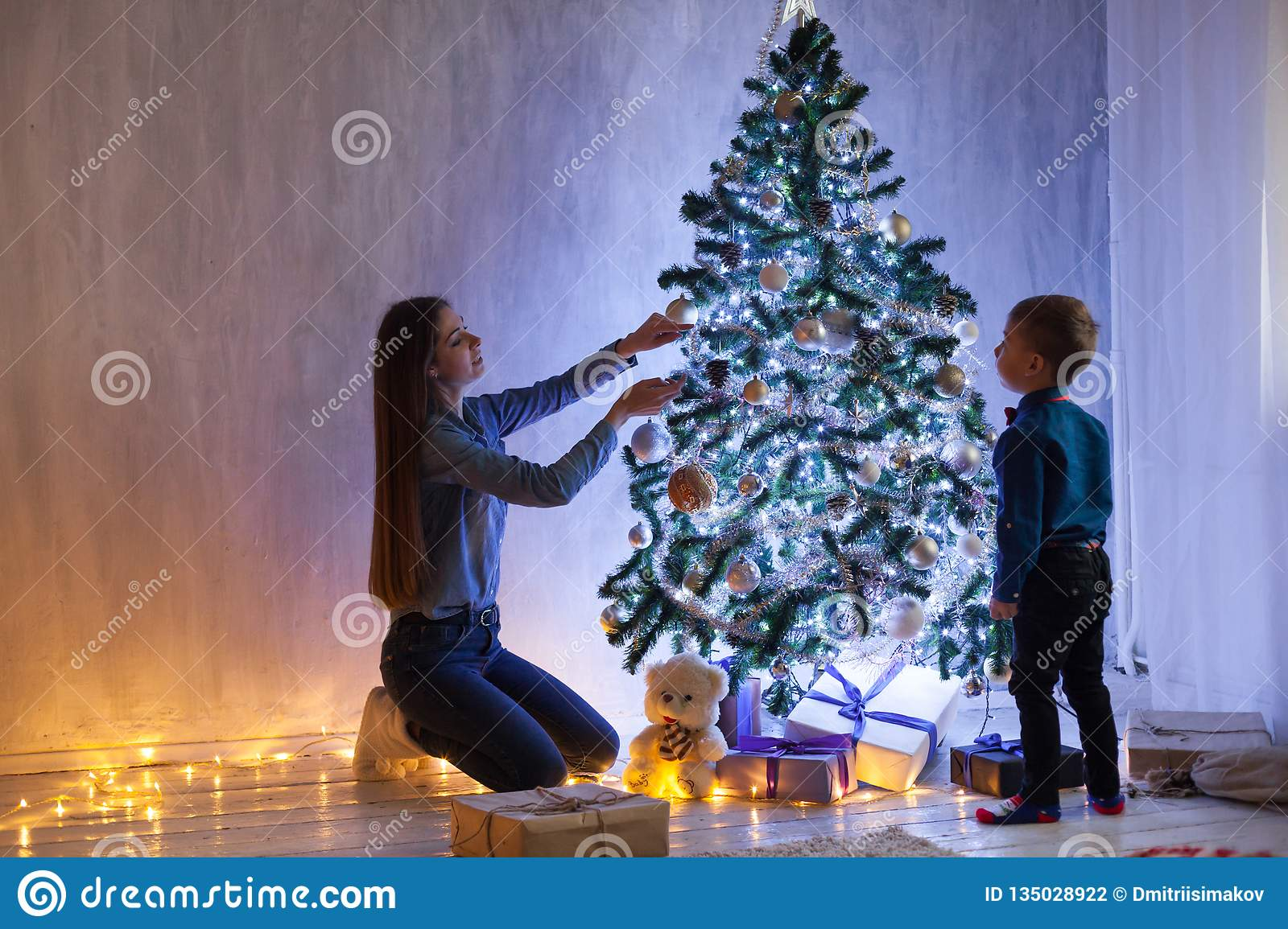 Mother And Son Dinner At Christmas Garland Lights New Year Gifts