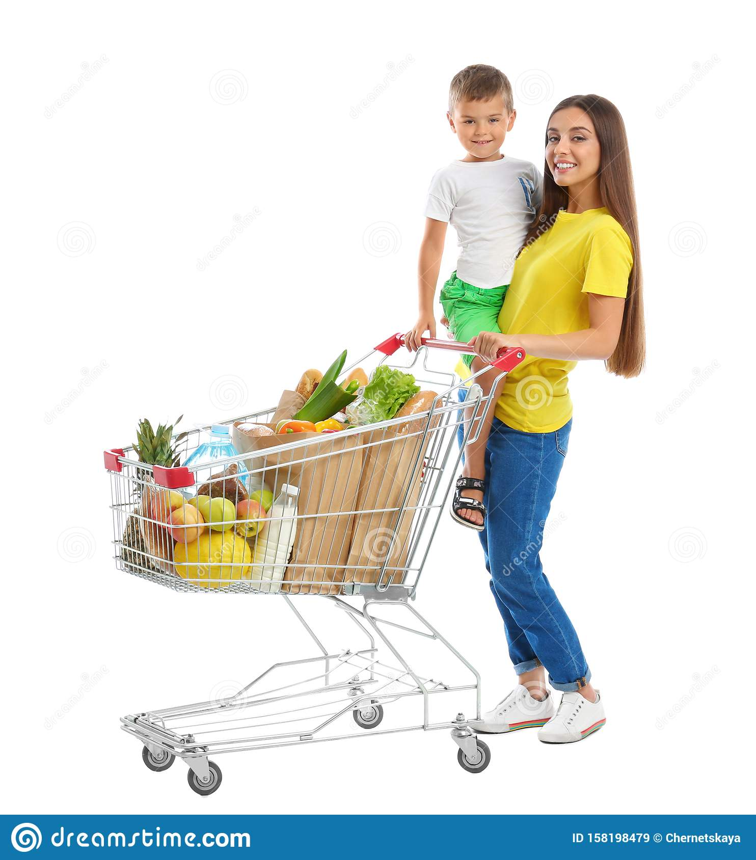 Mother and son with full shopping cart on background