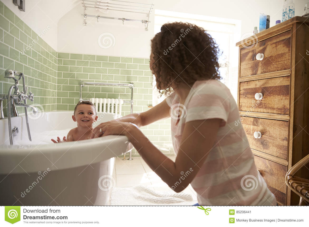 Mother And Son Having Fun At Bath Time Together Stock Image - Image ...